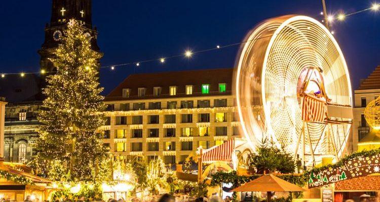 Twinkling lights Christmas tree Ferris wheel Dresden Christmas Market Germany