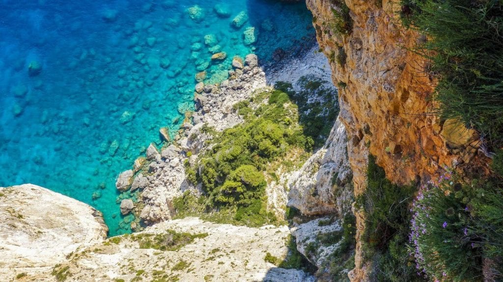 blue ocean cliffside Greece planning a trip to Europe