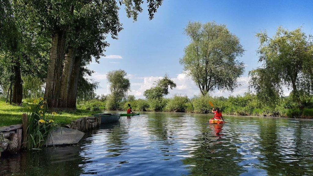 people canoeing down Ljubljana River Slovenia