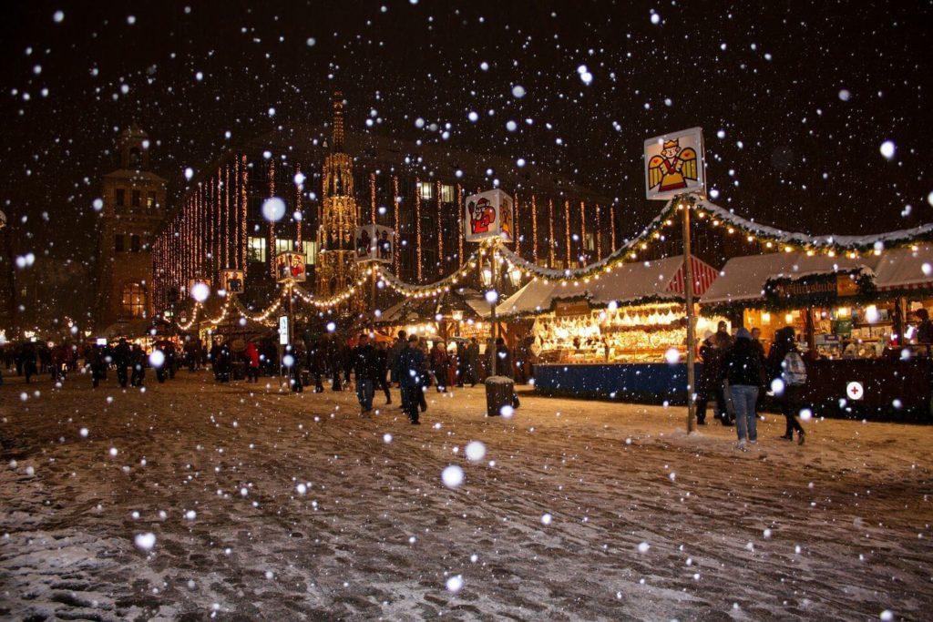 Snow falling Nuremberg Christmas markets Germany