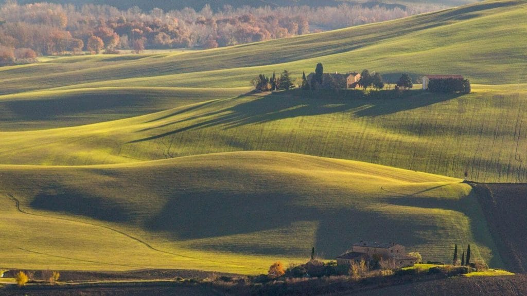 rolling green fields travelling to Italy