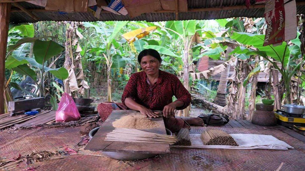 women making traditional handicrafts Peak Sneng village Cambodia