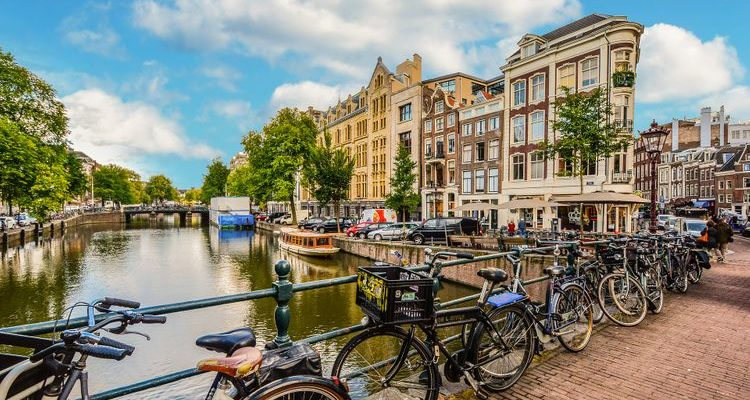 bicycles lined against Amsterdam canal