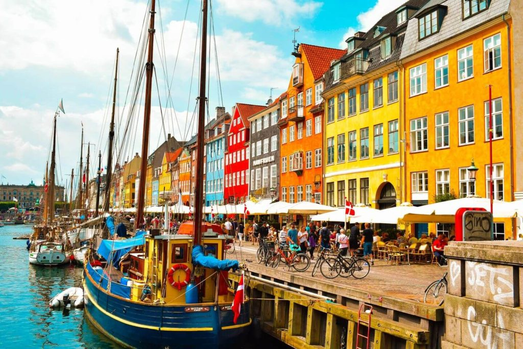 colourful buildings boats and bicycles Copenhagen Denmark