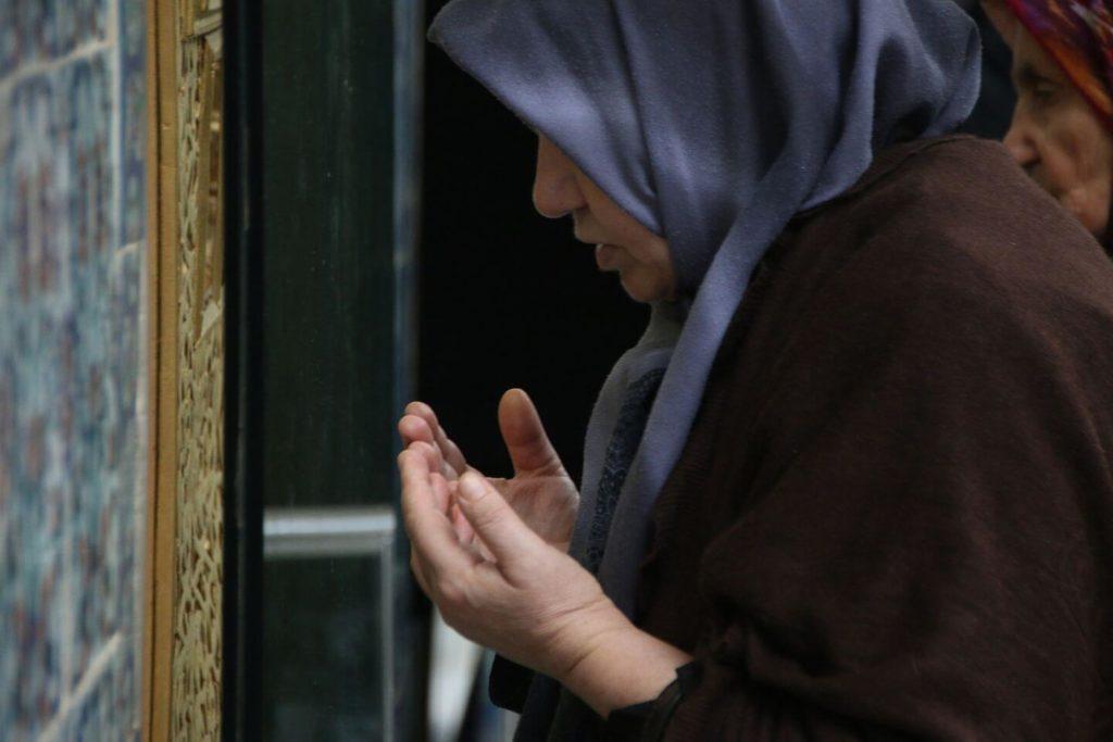 Muslim woman praying at Ramadan