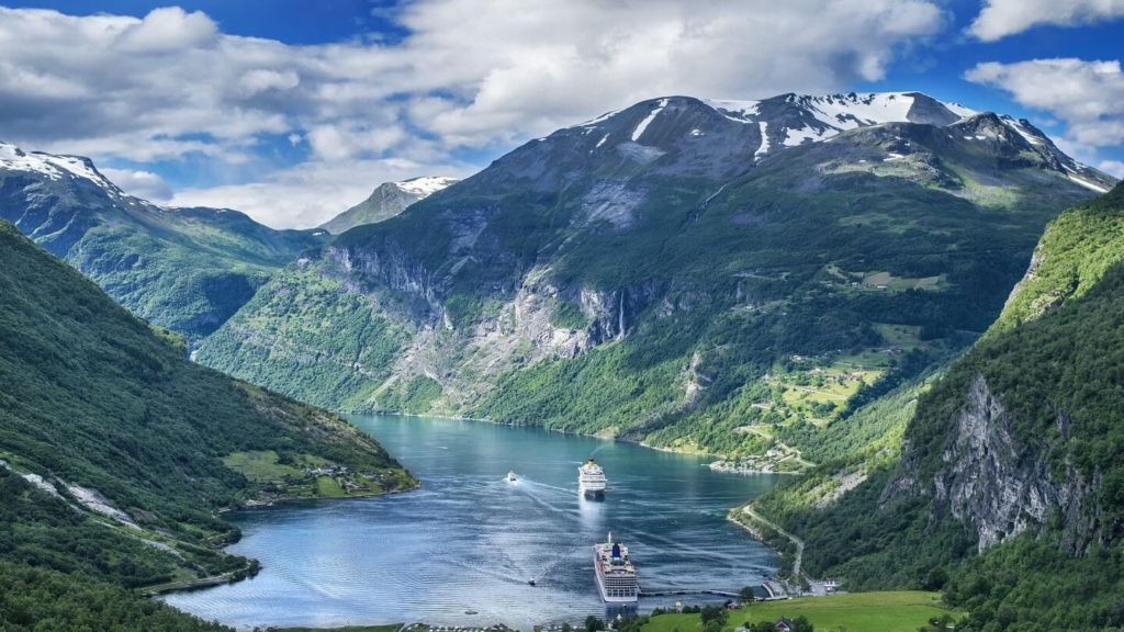 cruise ships sailing through the lush green landscapes of Norway's fjords