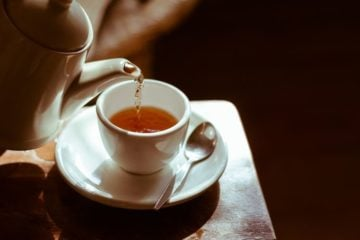 teapot pouring cup of tea
