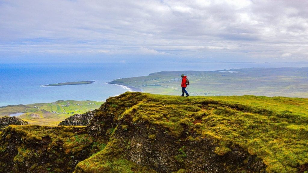 traveller walking through the Scottish Highlands