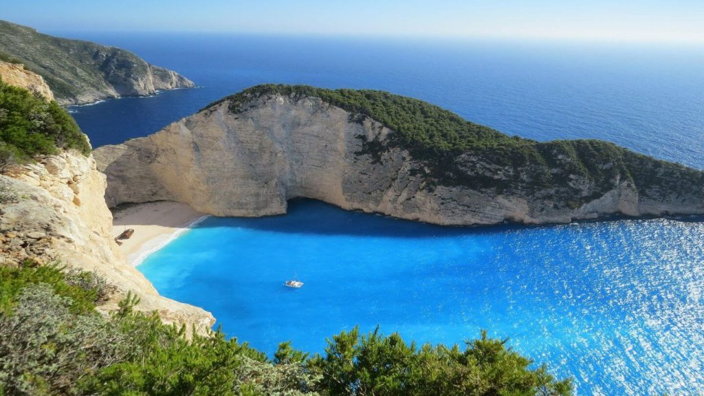 blue ocean green cliffs Zakynthos Greece