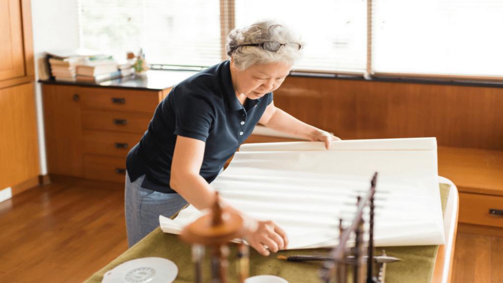Japanese woman making traditional washi paper