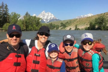 Happy family rafting in North America.
