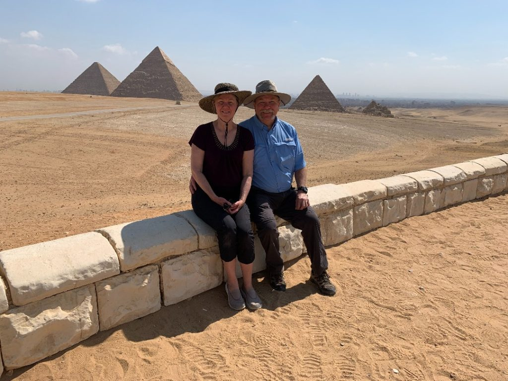 John and Diana Ramsey sitting in front of the pyramids