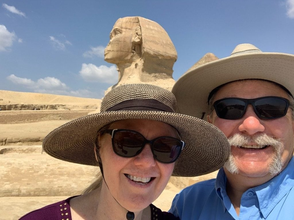John and Diana Ramsey smiling in front of Egyptian sphinx
