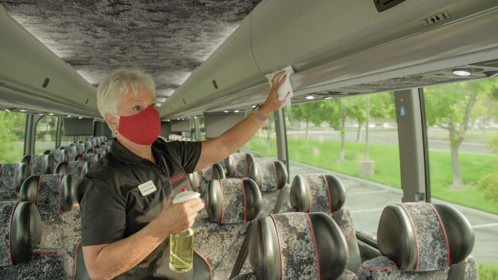 Trafalgar staff sanitising the coach
