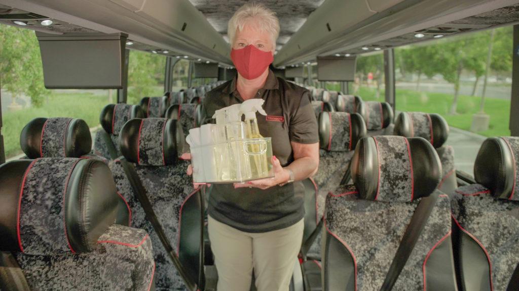 Trafalgar staff with hygiene equipment on board the coach