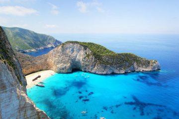 rugged cliffs blue water Zakynthos Greece