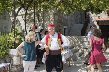 Trafalgar guests dancing with locals in Hvar on a Croatia Trafalgar trip