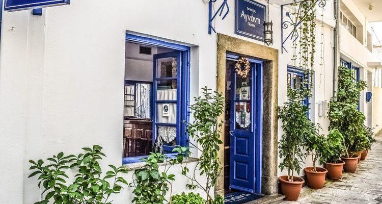 cobbled street blue doors Skopelos Greece