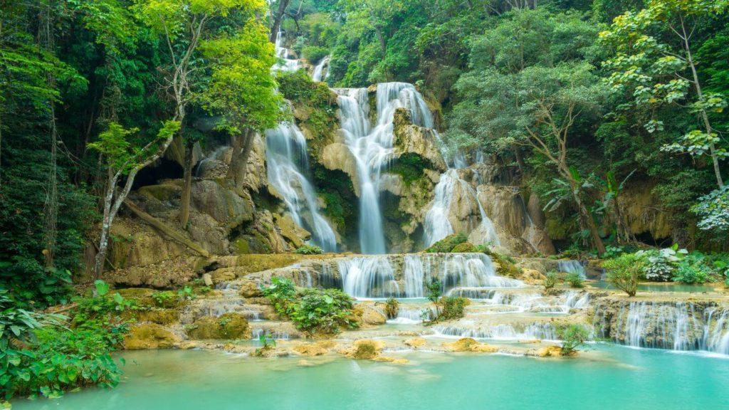 blue waters green jungle Kuang Si Falls Laos
