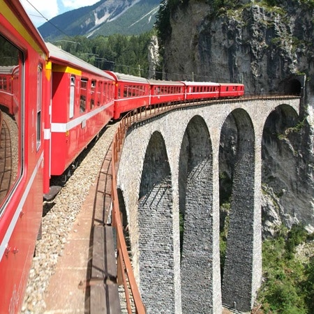 Switzerland Alps RedTrainBridge 2016 Hero SQ R 178364667 CruiseRailAndCombinations